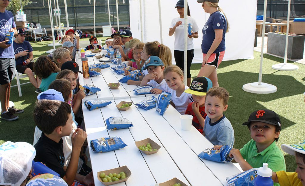 Children sitting at a table for a snack