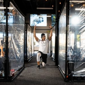With shower curtains, sanitization and social distancing, Los Angeles gyms reopen